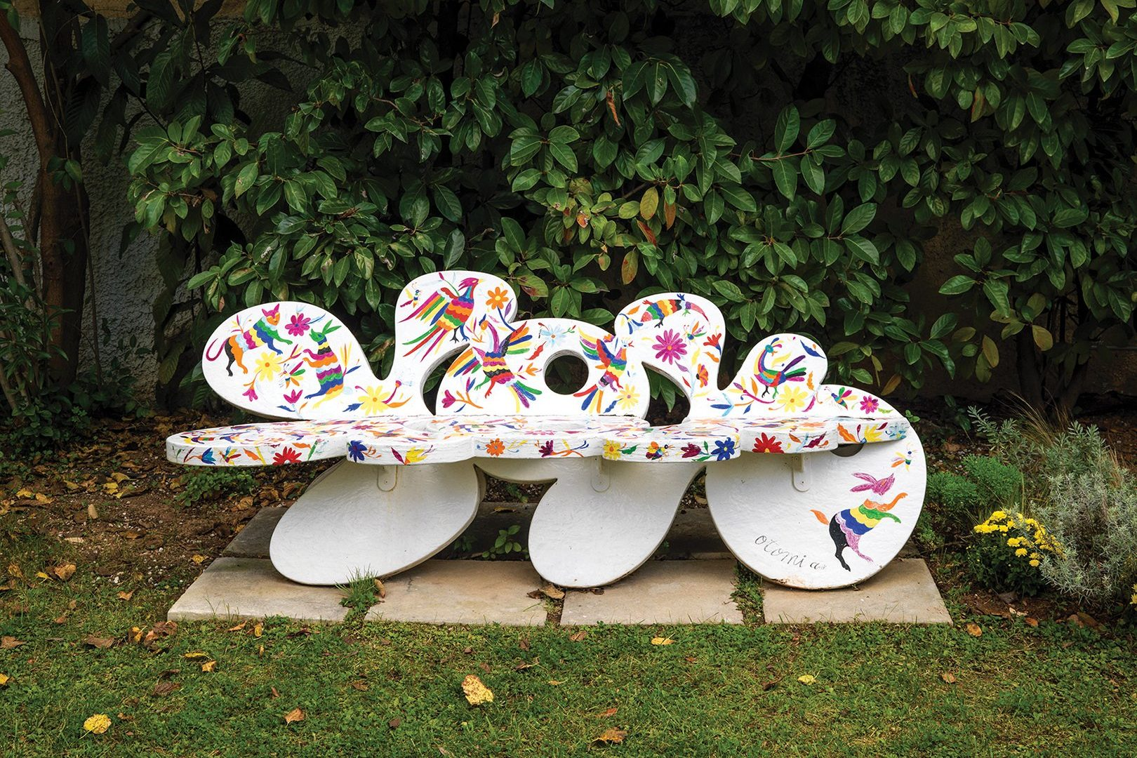 YoYo eco bench in the garden of Red Design Consultants, painted by Greek-Mexican artist Christine Grek